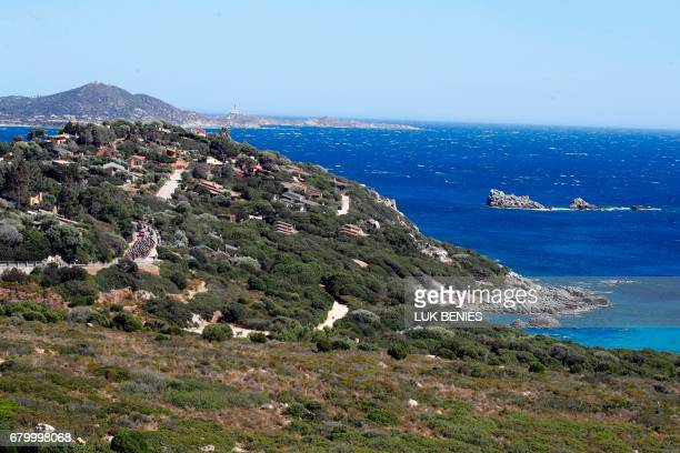 The peloton rides during the third stage of the 100th Giro d'Italia Tour of Italy cycling race from Tortoli to Cagliari on May 7 2017 in Sardinia...