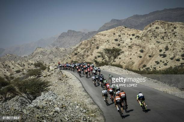 TOPSHOT The peloton rides during the third stage of the cycling Tour of Oman between the German University of Technology and Wadi Dayqah Dam in the...