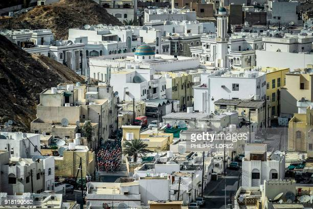 TOPSHOT The peloton rides in a street of alWadi alKabir during the second stage of the 2018 cycling Tour of Oman from Sultan Qaboos University to...