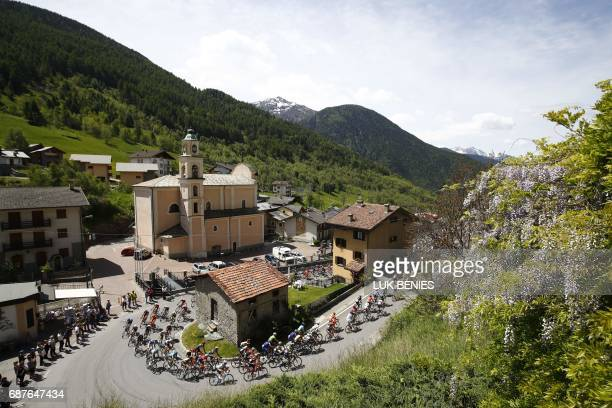 The peloton rides in Aprica during the 17th stage of the 100th Giro d'Italia Tour of Italy cycling race from Tirano to Canazei on May 24 2017 / AFP...