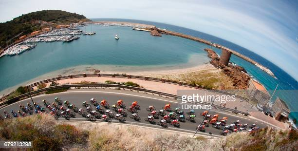 The peloton rides in Castelsardo al Porto during the first stage of the 100th Giro d'Italia cycling race Tour of Italy from Alghero to Olbia on May 5...