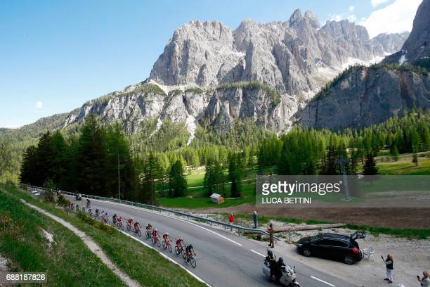 The peloton rides in the Dolomites mountains during the 18th stage of the 100th Giro d'Italia Tour of Italy cycling race from Moena to Ortisei on May...