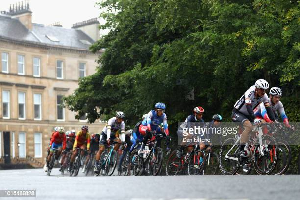 The Peloton rides in the Men's Road Race during the road cycling on Day Eleven of the European Championships Glasgow 2018 at on August 12, 2018 in...