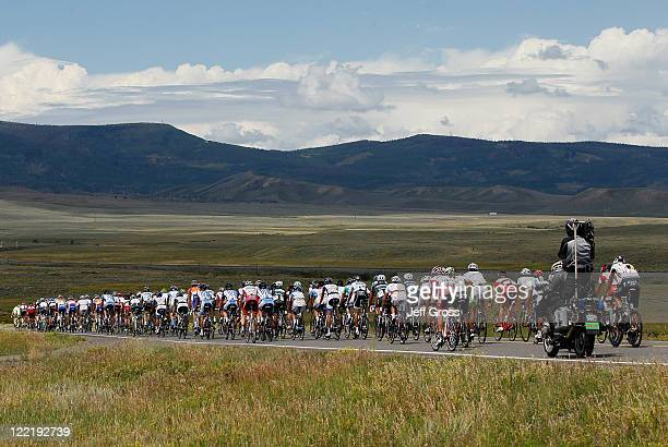 The peloton rides into a valley during stage four of the 2011 USA Pro Cycling Challenge from Avon to Steamboat Springs on August 26 2011 in Routt...