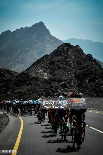 The peloton rides near the Omani capital Muscat during the second stage of the 2018 cycling Tour of Oman from Sultan Qaboos University to AlBustan...