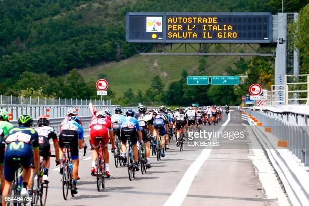 TOPSHOT The peloton rides on highway A1 during the 12th stage of the 100th Giro d'Italia Tour of Italy cycling race from Forli to Reggio Emilia of...