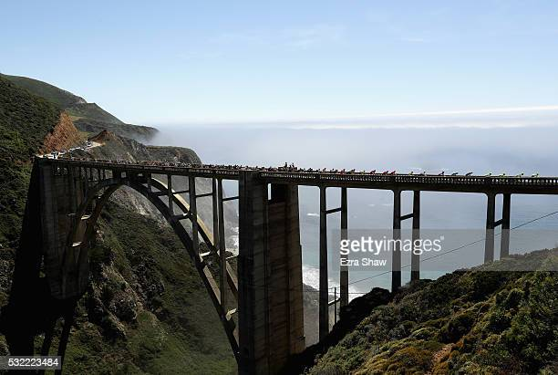 The peloton rides over the Bixby Bridge on their way from Morro Bay to Monterey County Mazda Raceway Laguna Seca during Stage 4 of the Amgen Tour of...