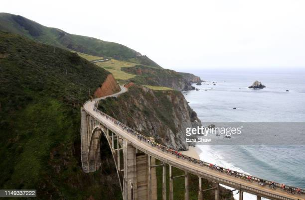 The peloton rides over the Bixby Creek Bridge during Stage 4 of the 14th Amgen Tour of California on May 15, 2019 in Big Sur, California.