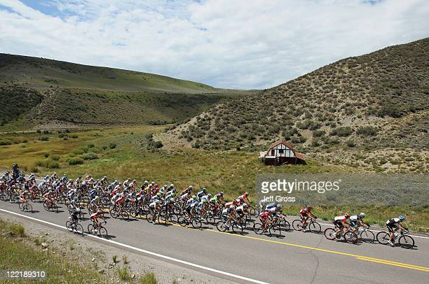 The peloton rides past a barn during stage four of the 2011 USA Pro Cycling Challenge from Avon to Steamboat Springs on August 26 2011 in Eagle...