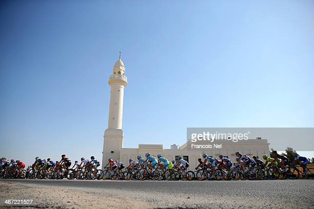 The peloton rides past a mosque during stage three of the 2014 Ladies Tour of Qatar from Katara Cultural Village to Al Khor Corniche on February 6,...