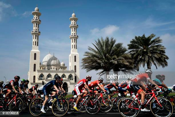 The peloton rides past a mosque near Sultan Qaboos University during the second stage of the 2018 cycling Tour of Oman from Sultan Qaboos University...