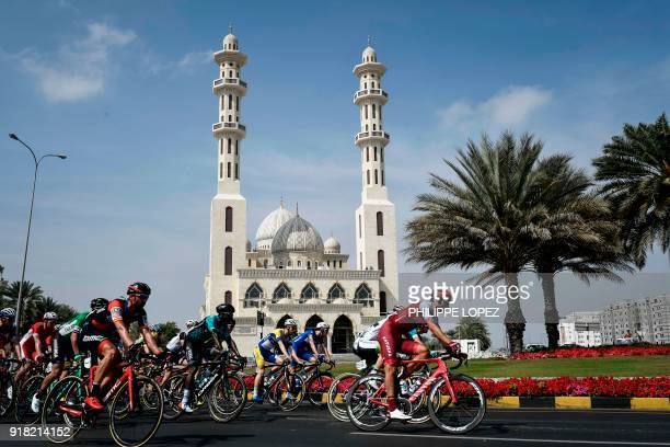 TOPSHOT The peloton rides past a mosque near Sultan Qaboos University during the second stage of the 2018 cycling Tour of Oman from Sultan Qaboos...