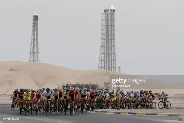 The peloton rides past an oil refinery during stage four of the 2014 Ladies Tour of Qatar from Sealine Beach Resort to Doha Corniche on February 7...