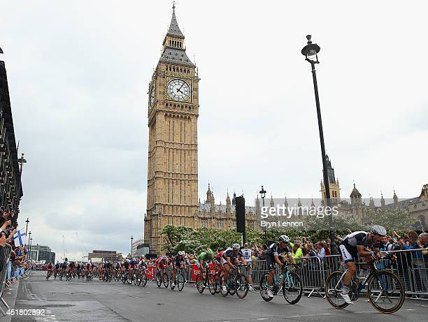 The peloton rides past Big Ben on the third stage of the 2014 Tour de France a 155km stage between Cambridge and London on July 7 2014 in London...