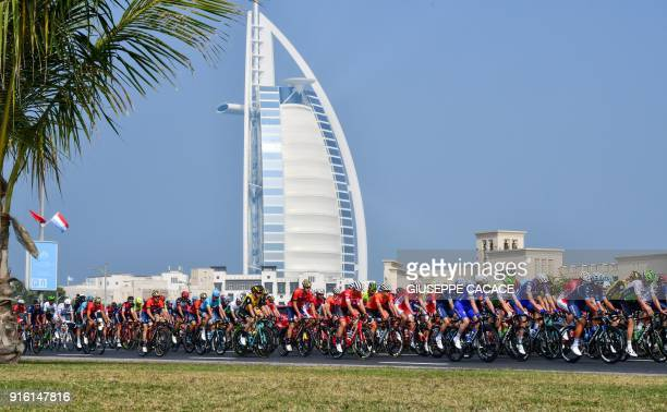 The peloton rides past Burj alArab hotel while heading from Sky Dive Dubai to Hatta during the fourth stage of the Dubai Tour on February 9 2018 /...