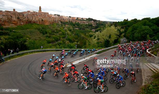 The peloton rides past Pitigliano during the stage four of the 102nd Giro d'Italia - Tour of Italy - cycle race, 235kms from Orbetello to Frascati on...