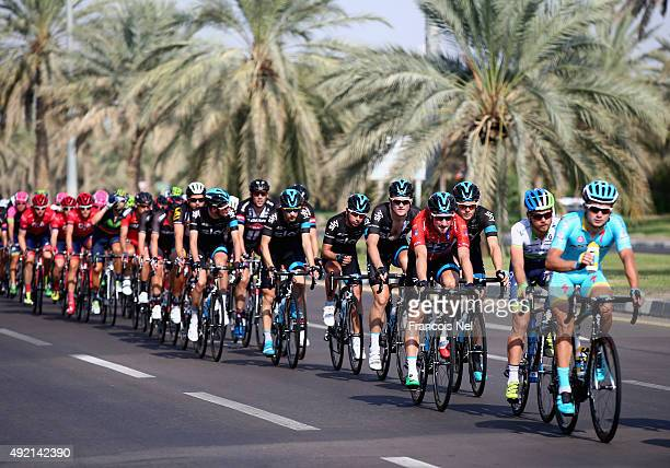 The peloton rides through Al Ain during stage three of the 2015 Abu Dhabi Tour from Al Qattara Souq to Jebel Hafeet on October 10 2015 in Abu Dhabi...