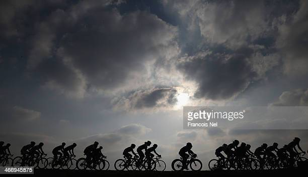 The peloton rides through Al Mafjar during stage two of the 2014 Ladies Tour of Qatar from Al Zubara to Madinat Al Shamal on February 5, 2014 in...