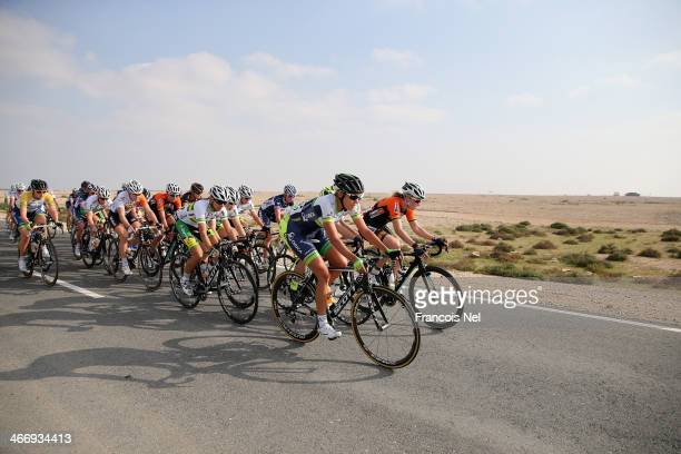The peloton rides through Al Mazzara during stage two of the 2014 Ladies Tour of Qatar from Al Zubara to Madinat Al Shamal on February 5, 2014 in...