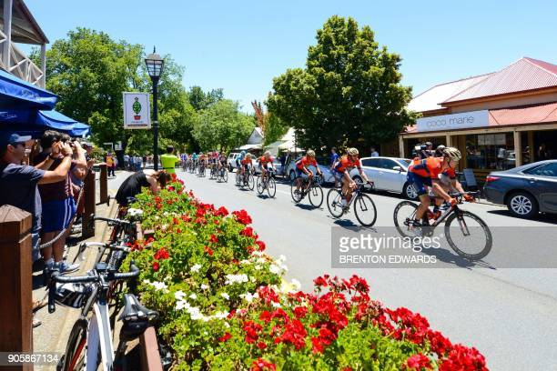 The peloton rides through Hahndorf on the second day of the Tour Down Under cycling race near Adelaide on January 17 2018 / AFP PHOTO / BRENTON...