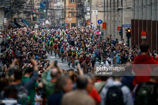 The peloton rides through the streets of the Italian city of Parma during the 13th stage of the 100th Giro d'Italia Tour of Italy cycling race from...