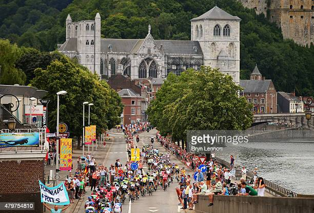 The peloton rides through the town of Huy during stage four of the 2015 Tour de France, a 223.5km stage between Seraing and Cambrai, on July 7, 2015...