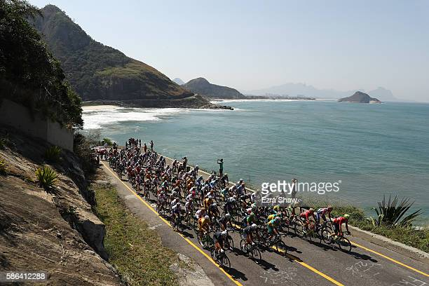 The peloton rolls through Grumari during the Men's Road Race on Day 1 of the Rio 2016 Olympic Games at the Fort Copacabana on August 6, 2016 in Rio...
