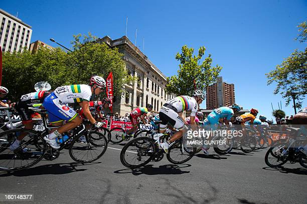 The peloton rounds a corner during the 90km stage 6 around the streets of Adelaide on the final day of the Tour Down Under cycling race in Adelaide...