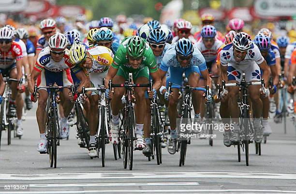 The peloton sprints towards the finish line as Tom Boonen in the middle in the green jersey of Belgium riding for the Quickstep Innergetic cycling...