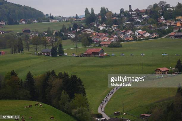 The peloton stretch out during stage four of the Tour de Romandie from Fribourg to Fribourg on May 3 2014 in Fribourg Switzerland