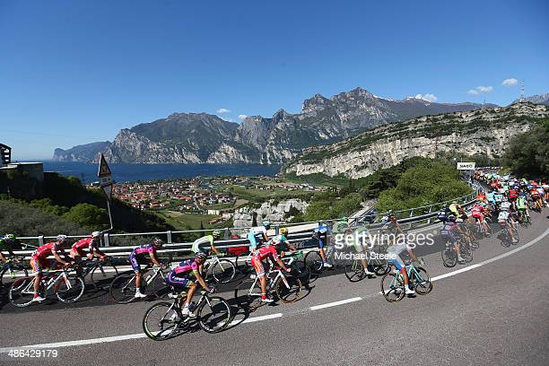 The peloton stretches out from the village of Nago above Lake Garda during stage three of the Giro del Trentino from Mori to Roncone on April 24 2014...