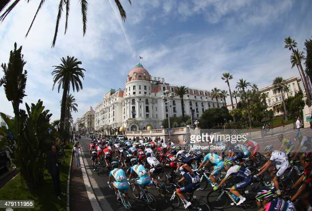 The peloton sweeps past the Hotel Negresco during stage 8 of the ParisNice race from Nice to Nice on March 16 2014 in Nice France