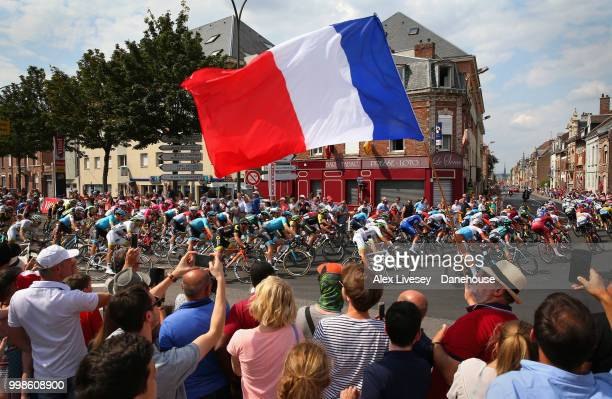 The peloton take a turn 4km before the finish of Stage 8 a 181km stage from Dreux to Amiens Metropole as supporters cheer them on during the 105th...
