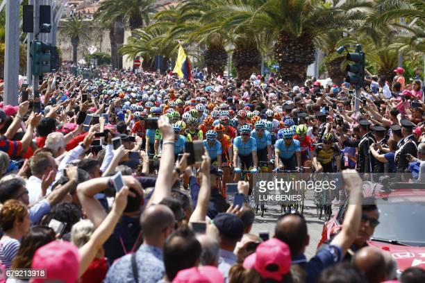 The peloton take the start of the first stage of the 100th Giro d'Italia cycling race Tour of Italy from Alghero to Olbia on May 5 2017 in Sardinia /...