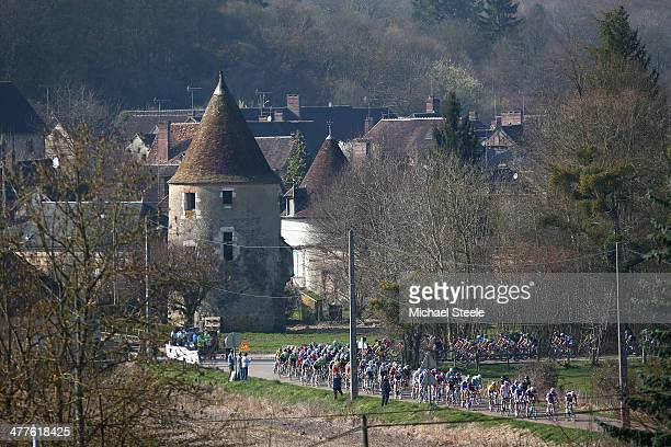 The peloton travels through the village of La FerteLoupiere during Stage Two of the Paris Nice race from Rambouillet to SaintGeorgessurBaulche on...
