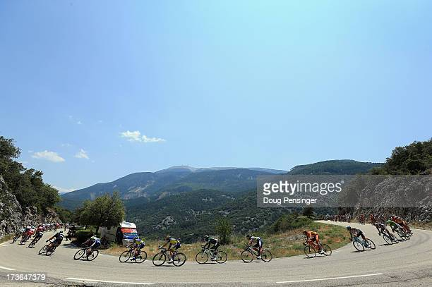The peloton winds through the hills with the Mount Ventoux in the background during stage sixteen of the 2013 Tour de France a 168KM road stage from...