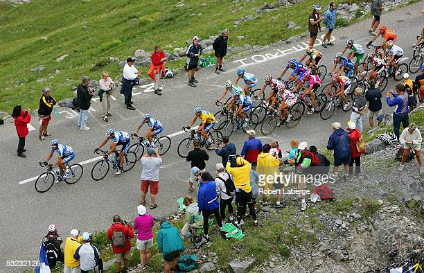 The peloton with Lance Armstrong of the USA riding for the Discovery Channel cycling team in the yellow jersey climbs the Col du Galibier during...