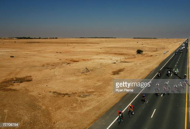 The peloton works it way through the desert during the Men's cycling road race during day three of the 15th Asian Games Doha 2006 on December 3 2006...