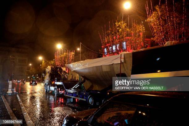 The Pen Duick racing yacht sailed by late French sailor Eric Tabarly is towed on the Champs Elysees near the Arc de Triomphe in Paris on November 27...