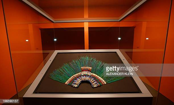 The Penacho feather headdress allegedly worn by Aztec emperor Moctezuma II is displayed at the Museum fur Volkerkunde in Vienna on November 16, 2012....