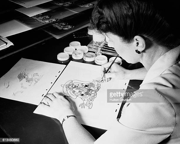 The pencil drawings for a picture are transferred onto a square of celluloid first through the process ink tracing then are painted on the back of...