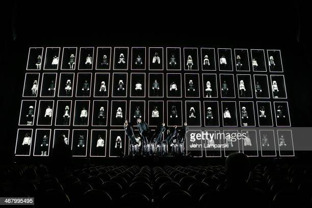 The Pendelum Choir by Swiss Artists Andre Decostard and Michael Decostard performs onstage at the Montcler Grenoble Fall 2014 presentation at...