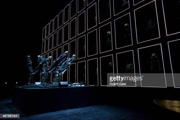 """The """"Pendelum Choir"""" by Swiss artists Andre Decosterd and Michel Decosterd performs onstage at the Moncler Grenoble Fall 2014 Presentation at the..."""