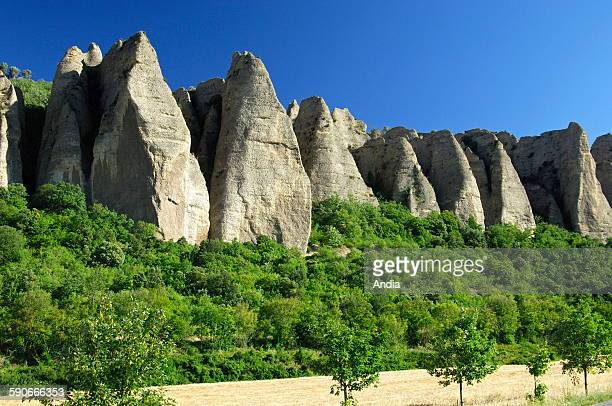 """The """"Penitents de Mees"""" , rows of rocks, rock formations due to erosion. Basalt plugs, fairy chimney, rock formation, geological formation"""