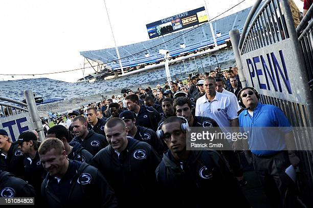 The Penn State Nittany Lions football team leaves the field following a pep rally at Beaver Stadium on August 31 2012 in State College Pennsylvania...