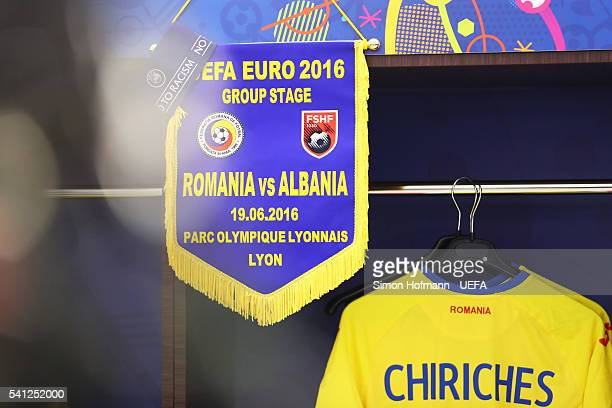 The pennant and a captain's arm band of Albania is hung along with the shirt worn by Alexandru Chipciu of Romania in the dressing room prior to the...