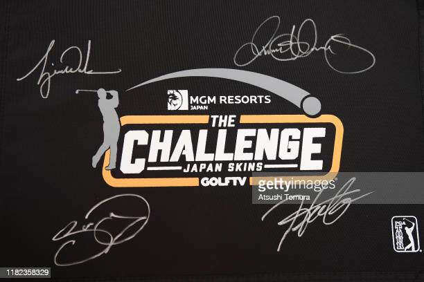 The pennant with autographs of Tiger Woods of the United States Rory McIlroy of Northern Ireland Jason Day of Australia and Hideki Matsuyama of Japan...