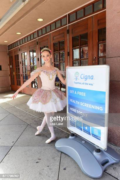 The Pennsylvania Ballet's Nutcracker cast visits Cigna's Health Improvement Tour in front of the Merriam Theatre to get their free biometric...