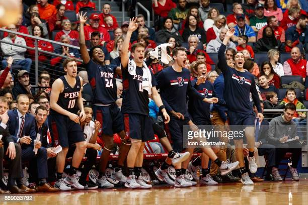 The Pennsylvania Quakers bench reacts during the first half of a game between the Dayton Flyers and the Pennsylvania Quakers on December 09 2017 at...