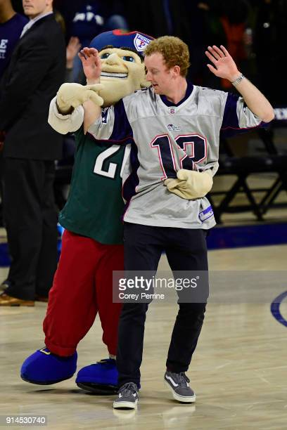 The Pennsylvania Quakers mascot captures a Pariots fan in an act in celebration of Super Bowl LII during the second half at The Palestra on February...